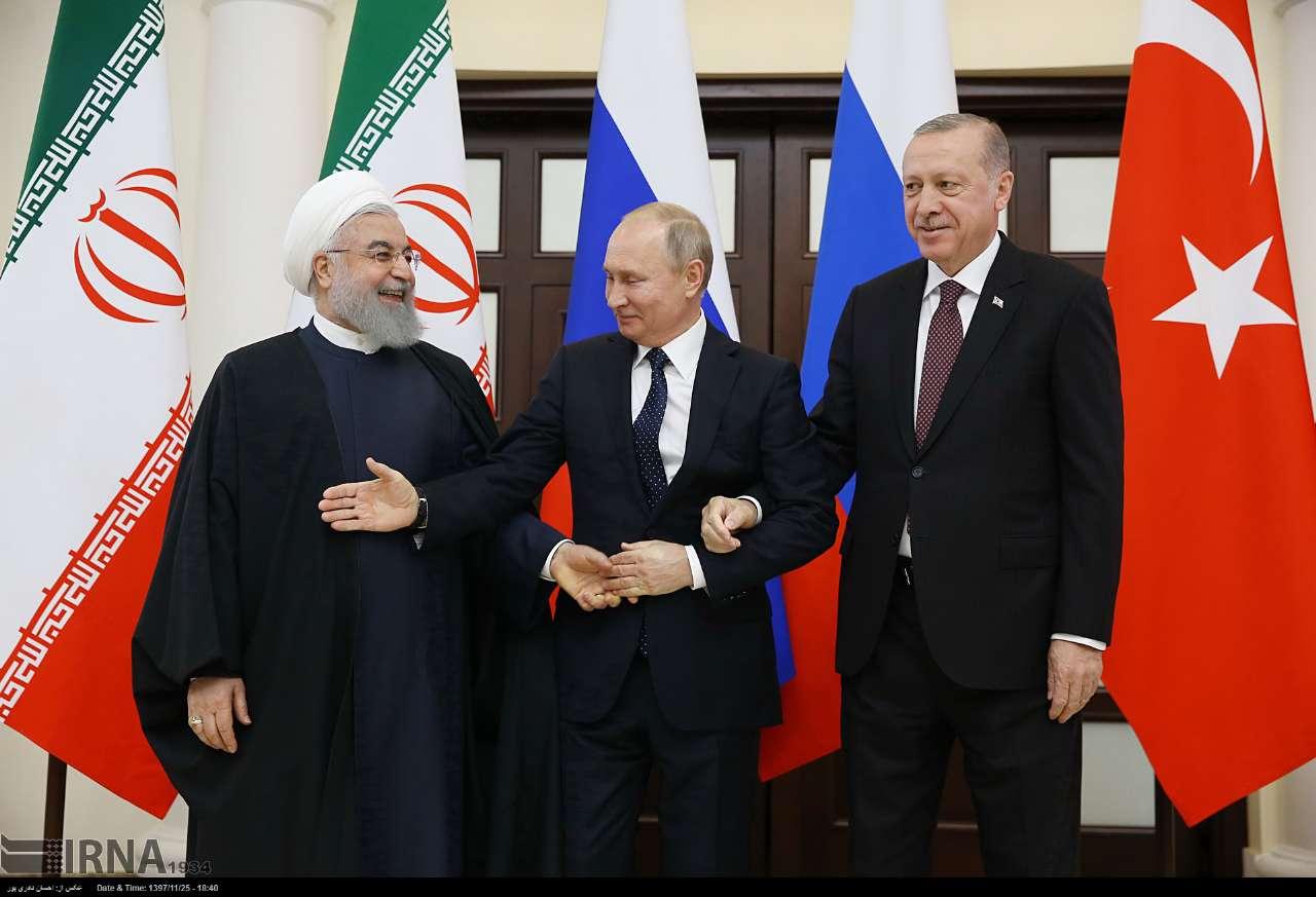 عکسی از پوتین که می خواهد با هر دو دست روحانی دست بدهد!