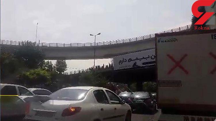 ماجرای خودکشی یک تهرانی روی پل همت + عکس