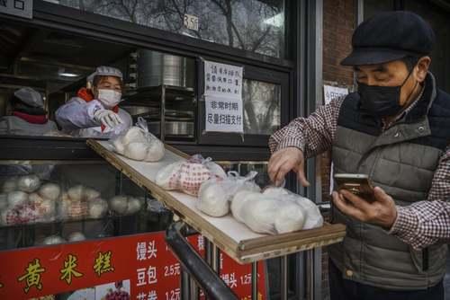 تمهیدات بهداشتی یک کلوچه فروشی در شهر پکن + عکس