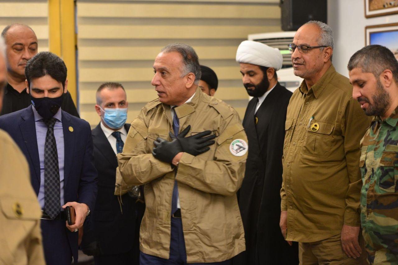 نخست وزیر جدید عراق در مقر حشدالشعبی و با لباس رسمی آنها + عکس
