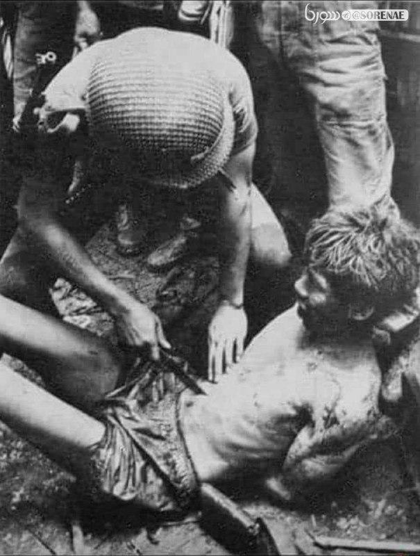 شکنجه عجیب اسیر ویتنامی توسط سرباز آمریکایی + عکس