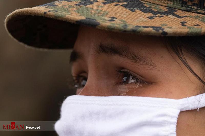 گریه زن نظامی از تمرینات سخت + عکس