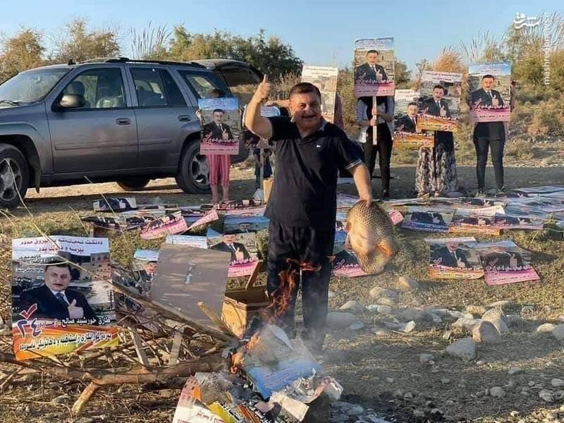 کاندیدای شکستخورده عراق پوسترها را کباب کرد + عکس