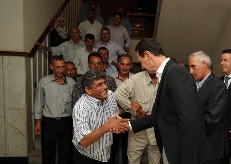 دیدار رئیس جمهور با کارگران سوری + عکس