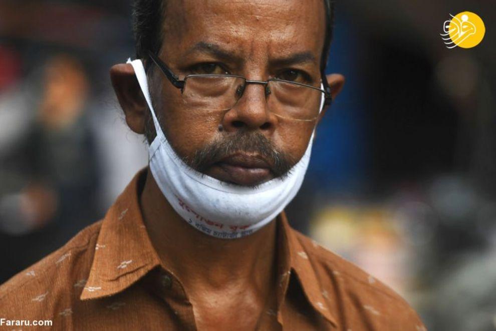 57977879 - دهن کجی هندیها به ماسک زدن! + عکس