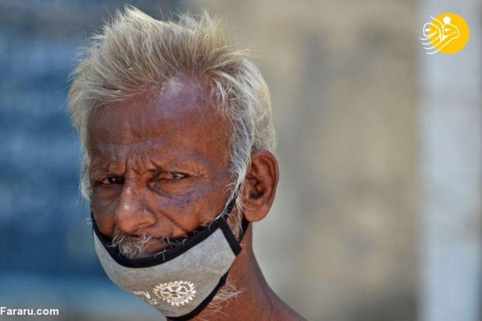 75898979 - دهن کجی هندیها به ماسک زدن! + عکس