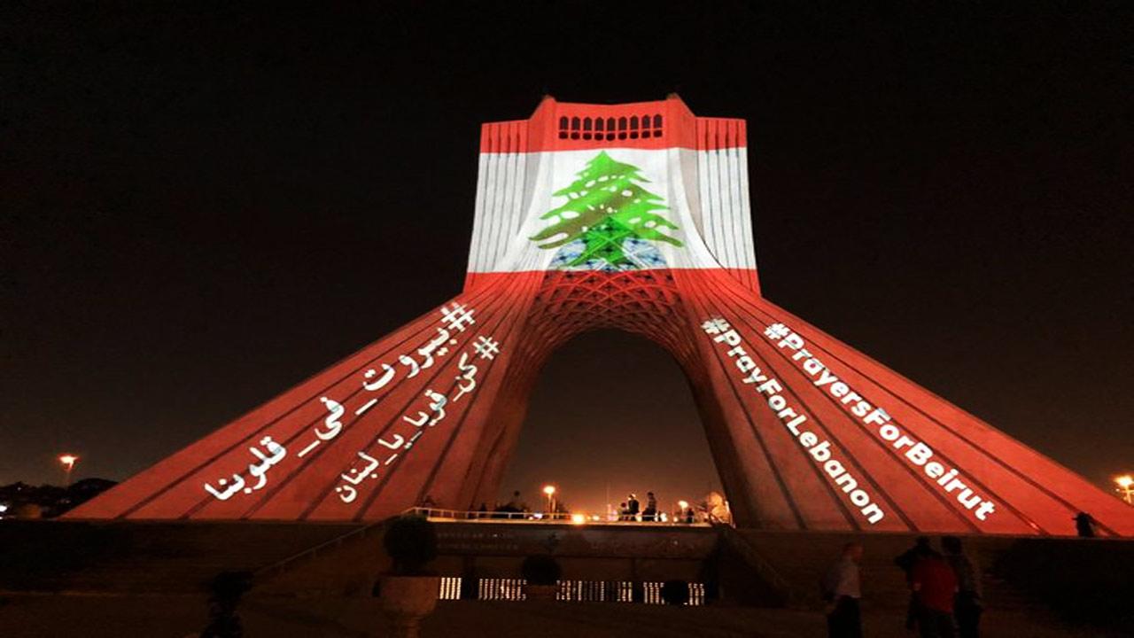12359162 986 - نقش بستن پرچم لبنان بر روی برج آزادی تهران + عکس